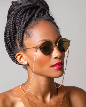 Pink Convertible Optical Necklace on sunglasses on model
