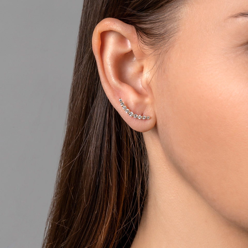 product_details::Crescent Ear Climber Studs on model
