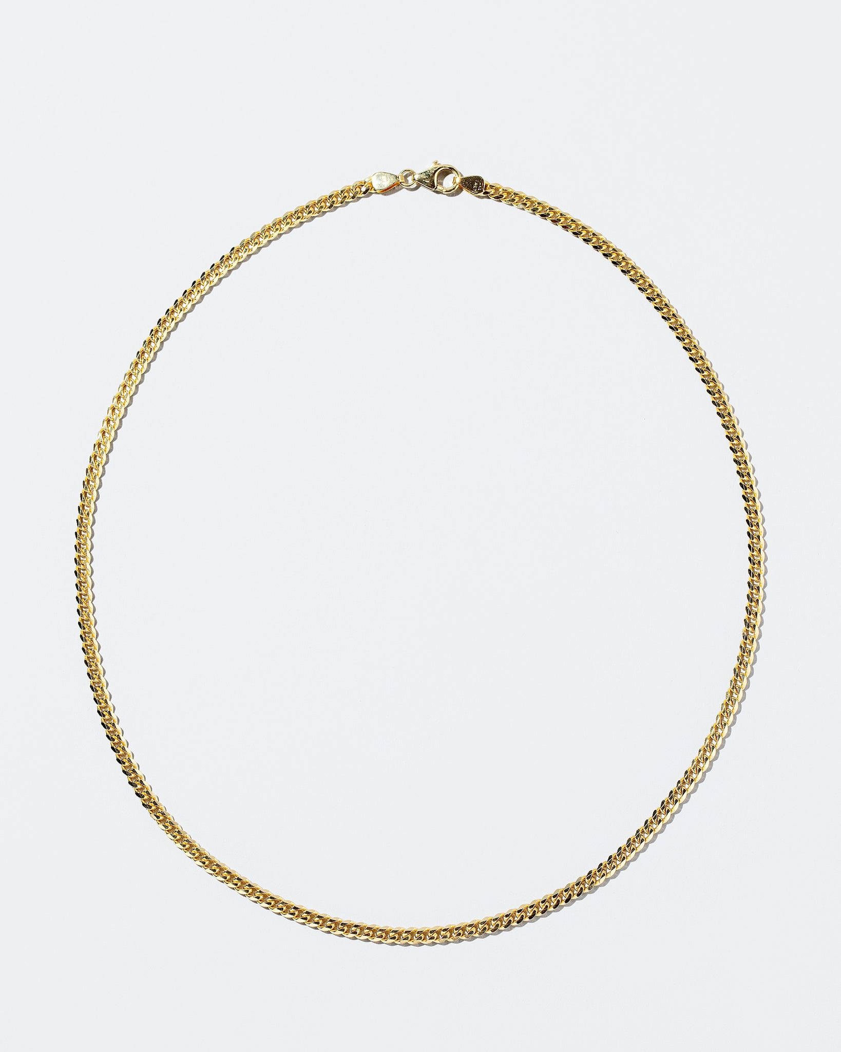 Curb Chain Necklace 3.4 mm on flat surface