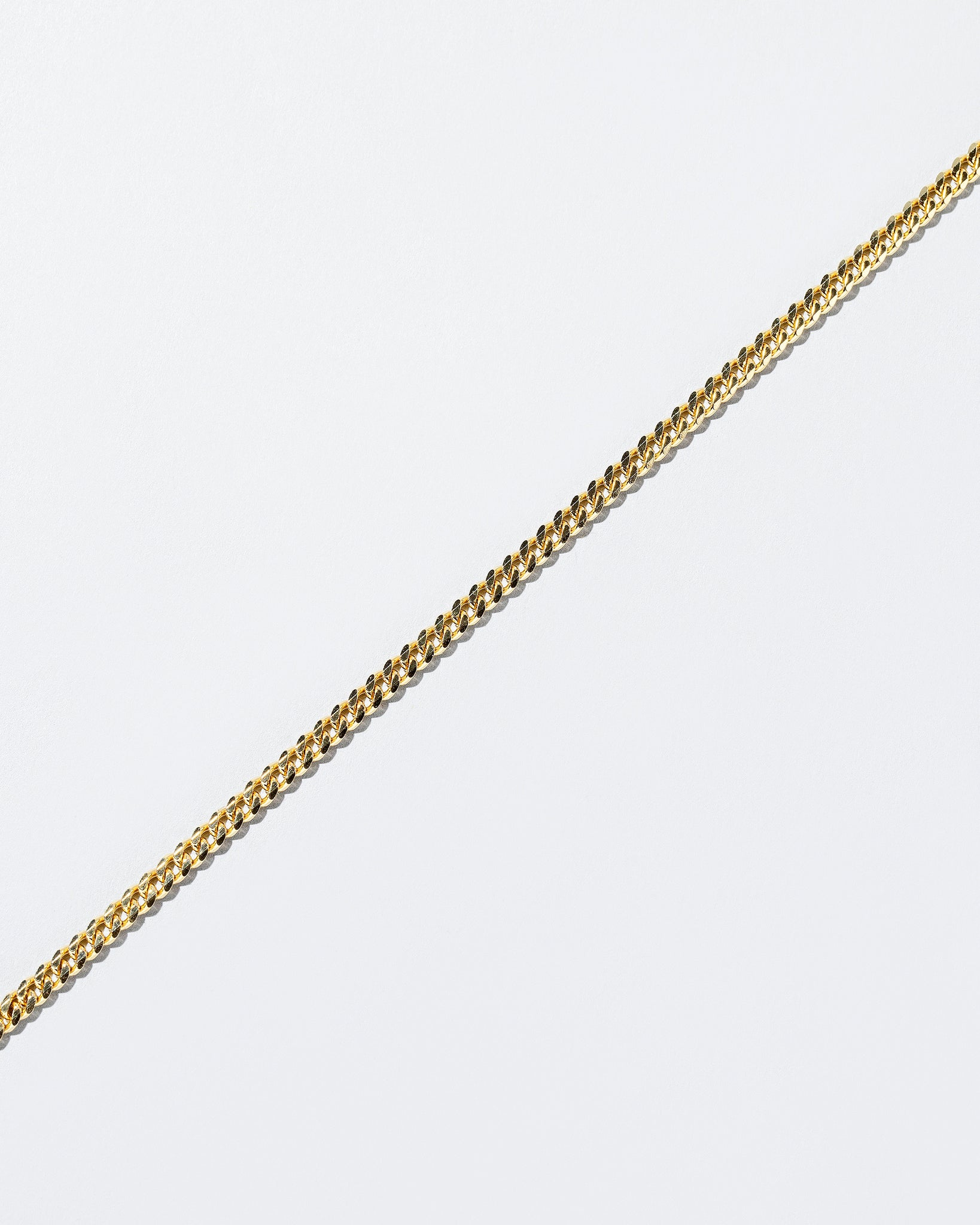 Curb Chain Necklace 3.4mm on flat surface close up