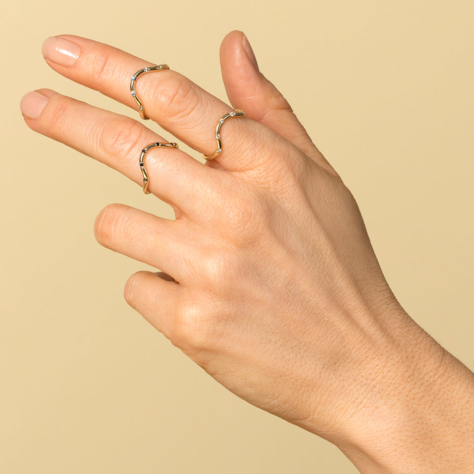 product_details:: Curved Band with Five Stones
