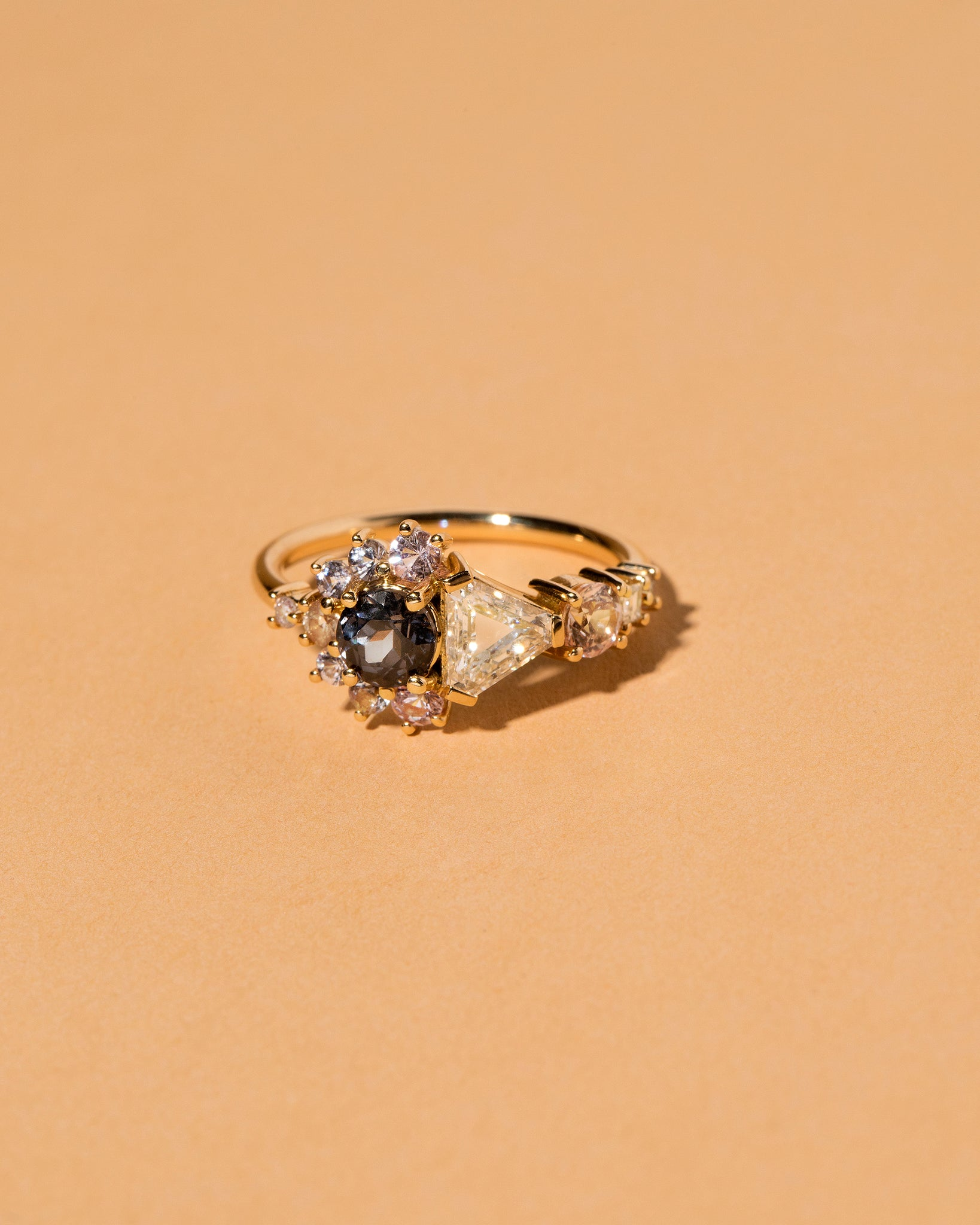 Diamond, Spinel & Sapphire Cluster Ring on light color background