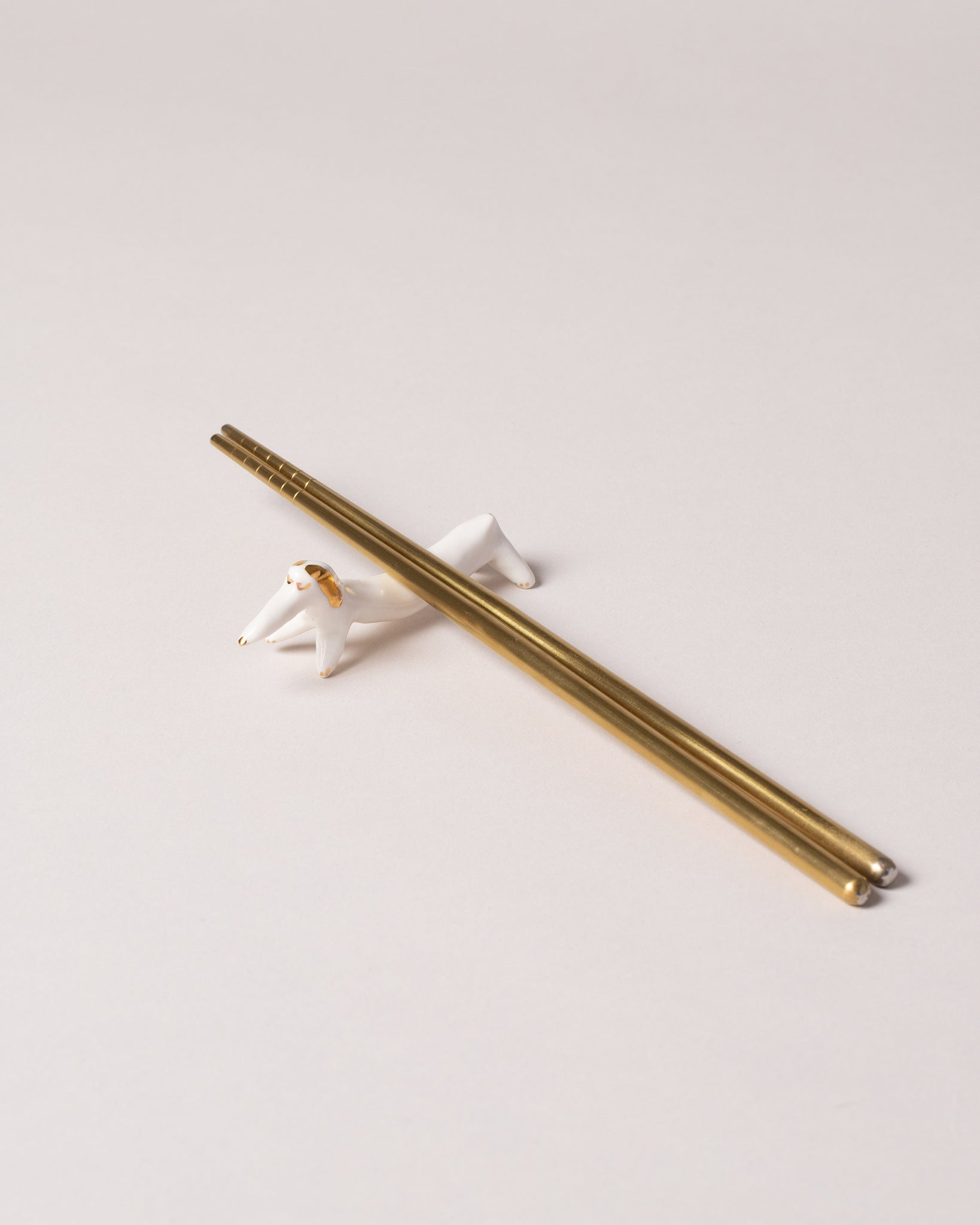 Chopstick Dog Rest Gold Styled