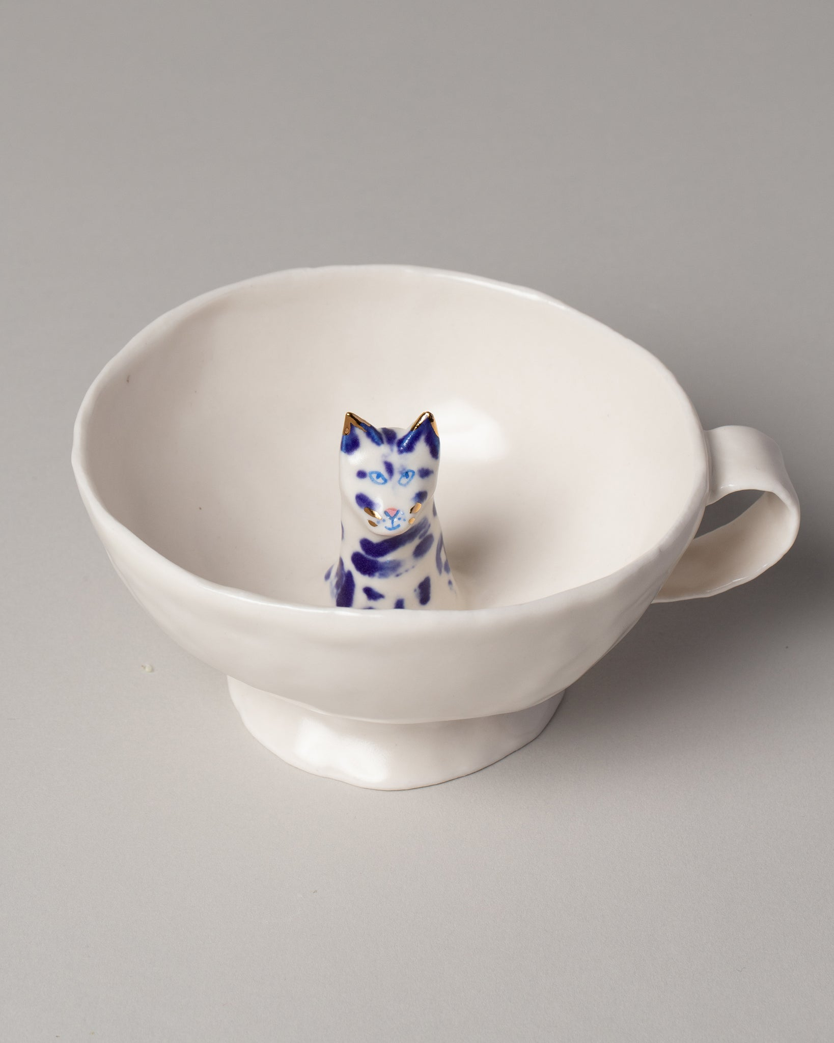Eleonor Boström Cat Cup on light color background.
