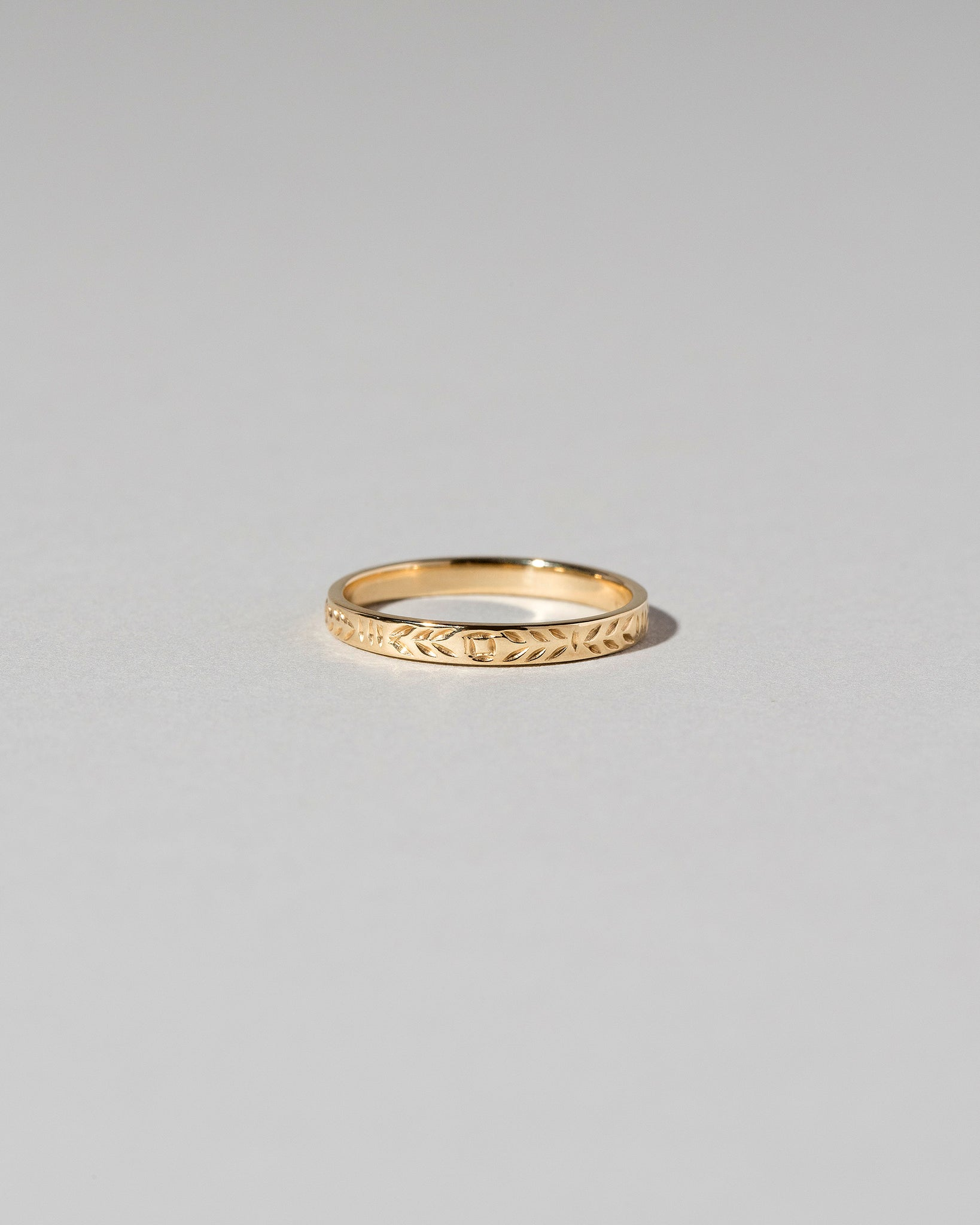 Front view of Etched Infinity Pattern Band in yellow gold