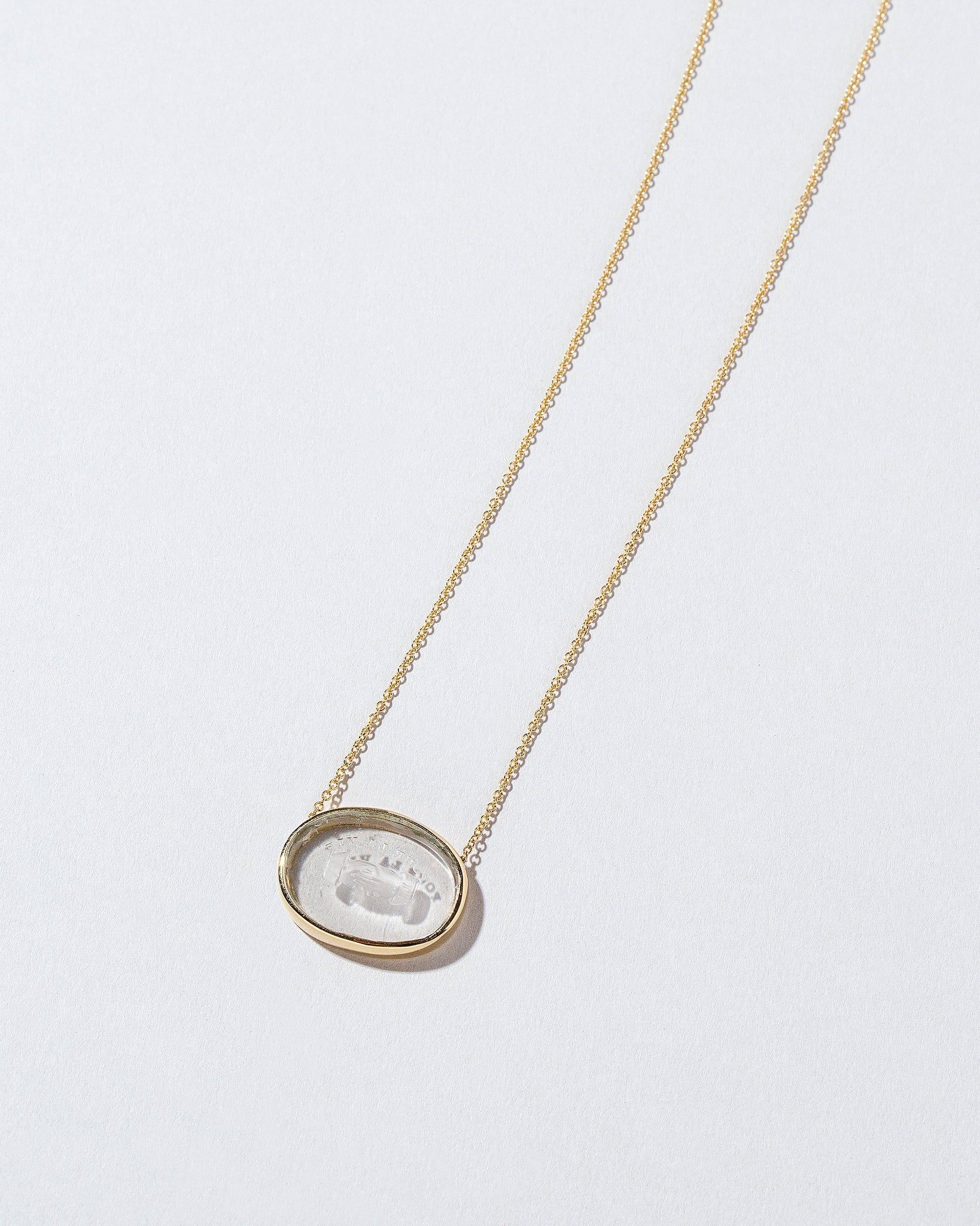 Eternity Intaglio Seal Necklace on light color background