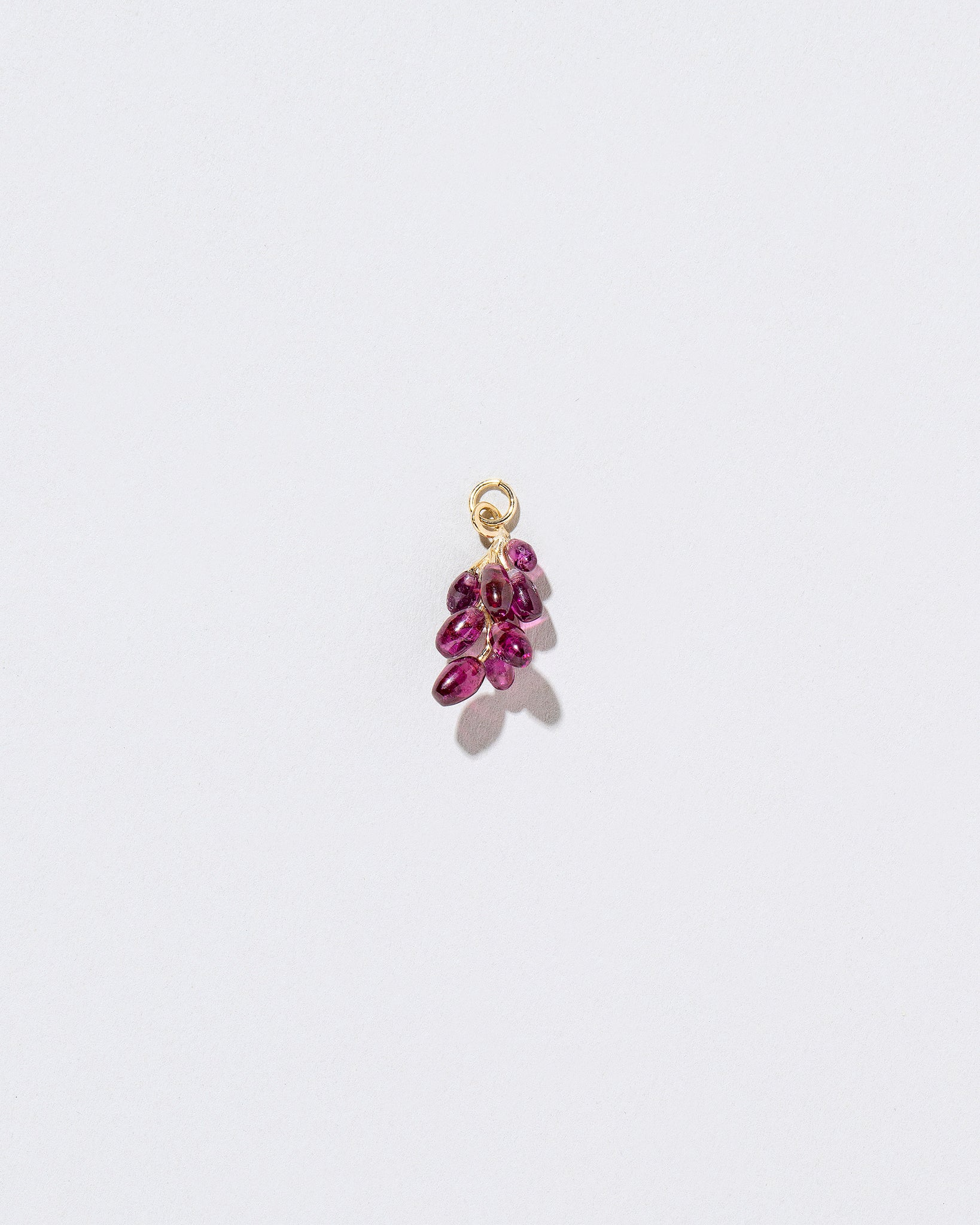 Grape charm on necklace