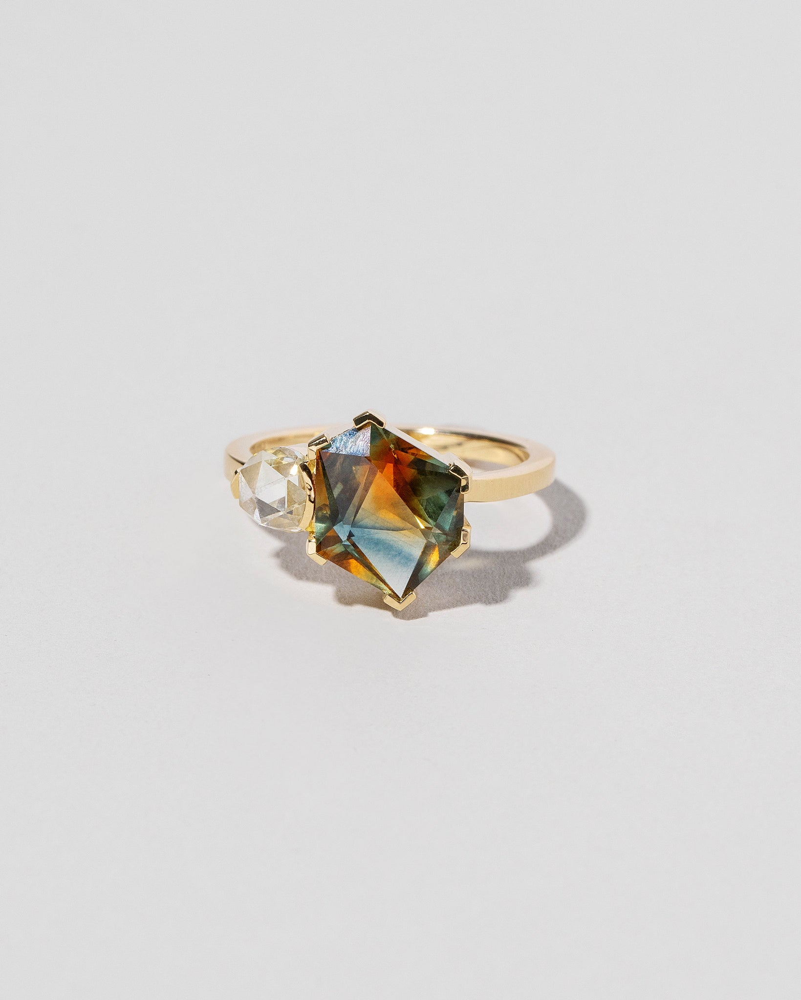 Kaleidoscope Sapphire Geometric Ring on light color background