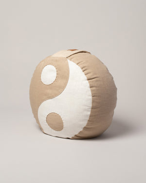 Kaschuba Hommage Yin Yang Pillow in Nude style on flat surface