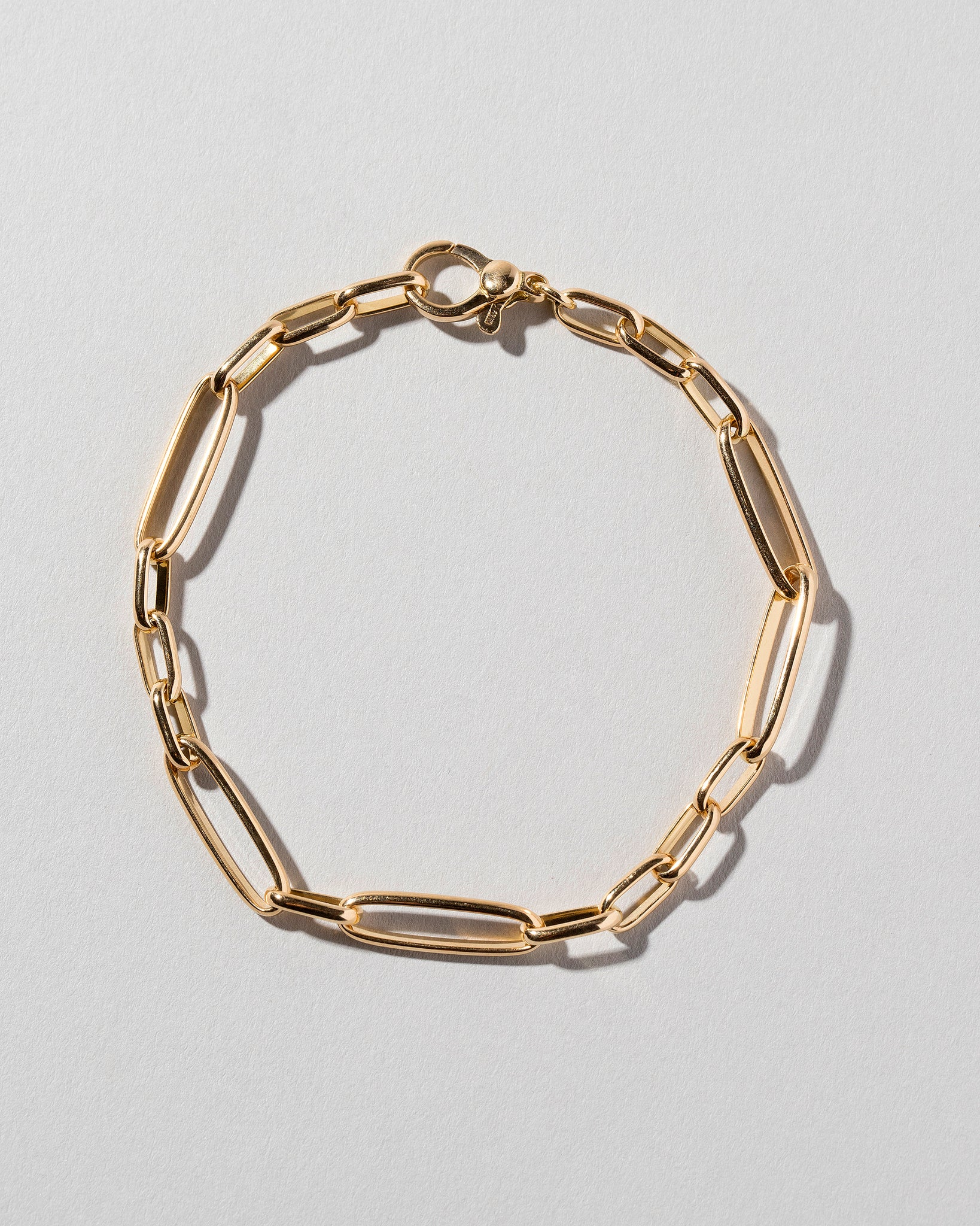 Long Loop Chain Bracelet on light color background