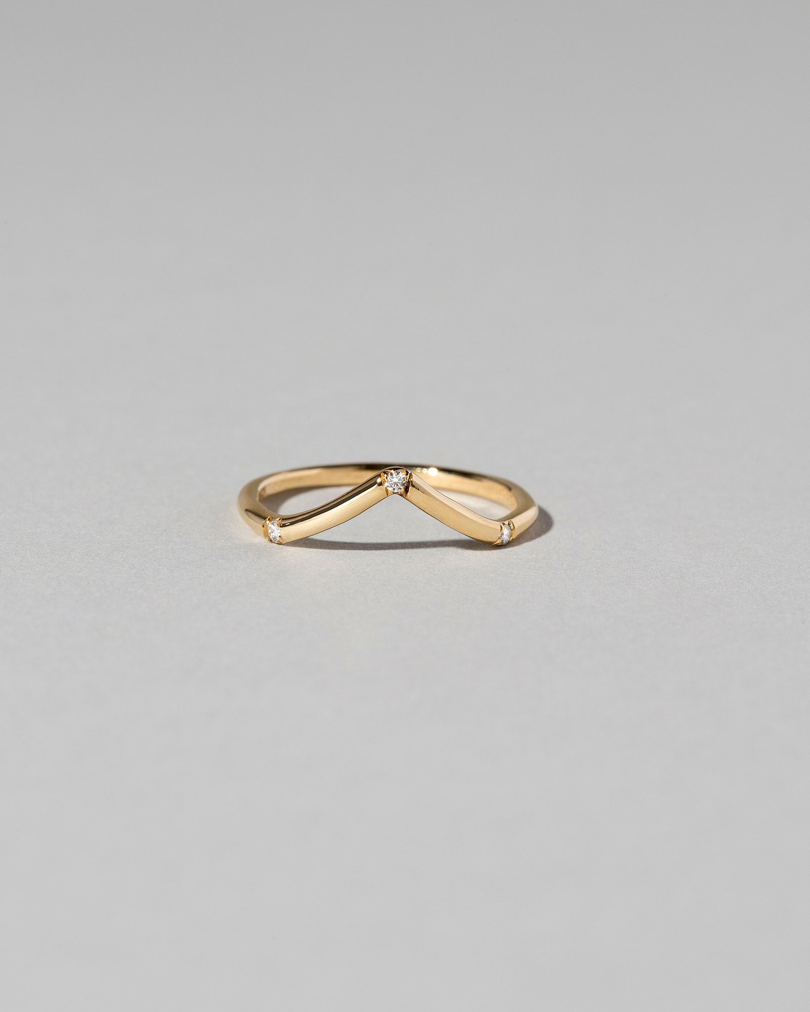 Front view of Mini Peak Band with Three Stones with white diamonds