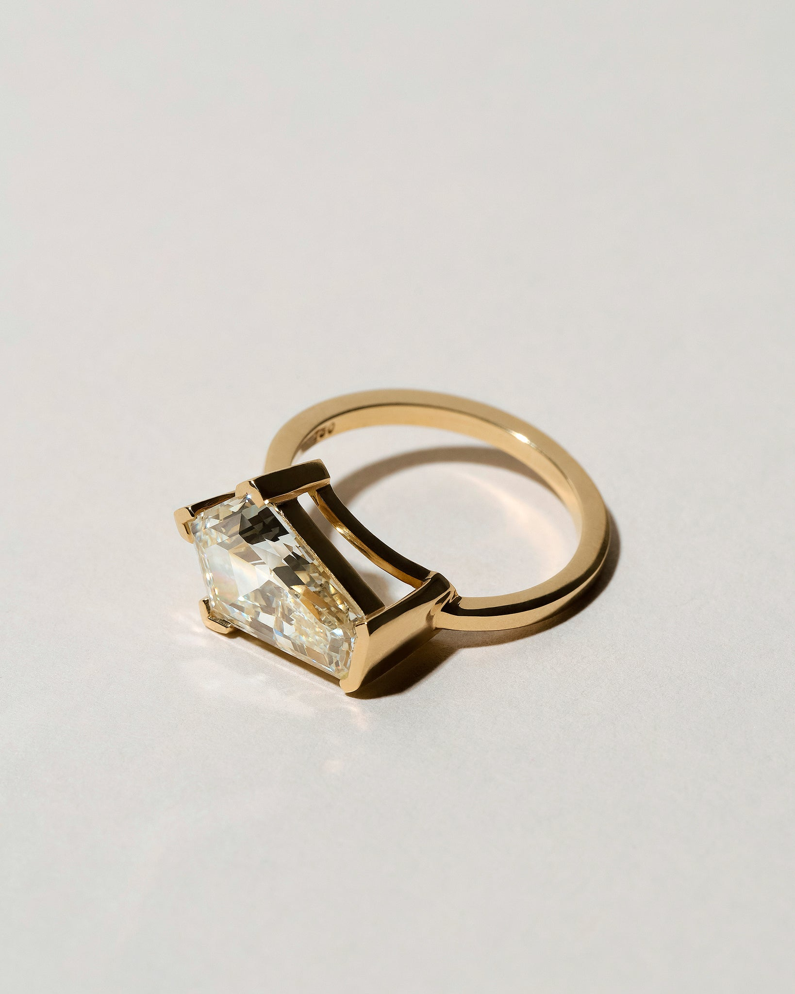 Modified Step Cut Diamond Ring on light color background.
