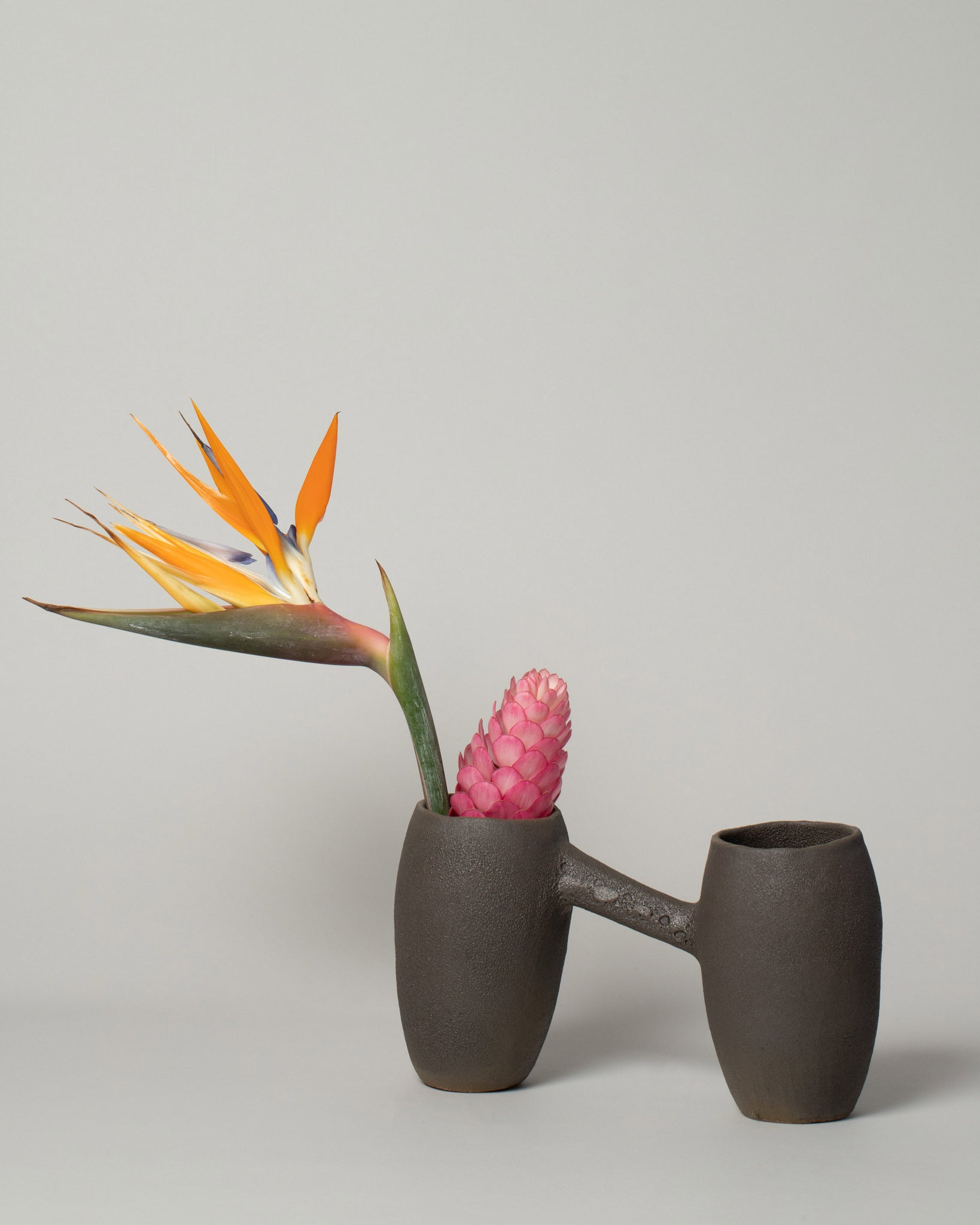 Nur Ceramics Zir Vessel front facing stylized with tropical flowers