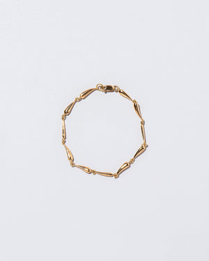 Accumulation Bracelet on flat surface