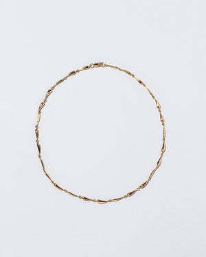 Accumulation Necklace on flat surface