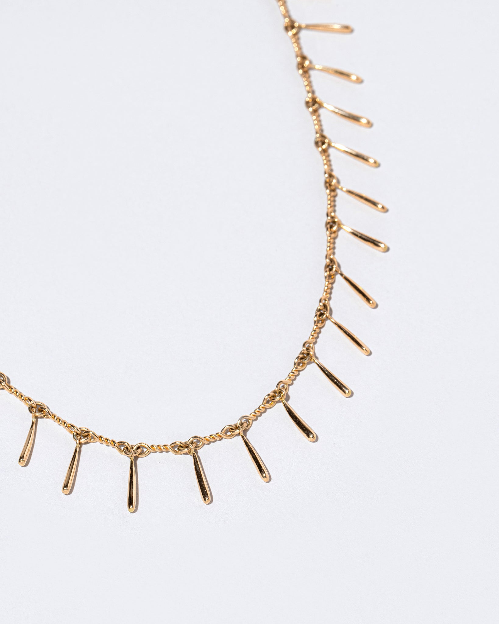 Swaying Necklace on flat surface close up