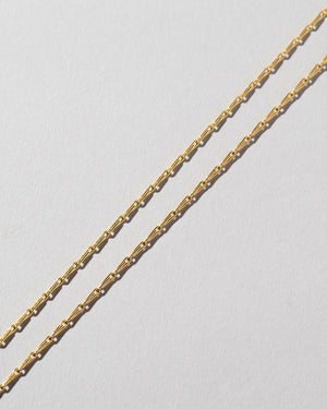 Petite Pinched Loop Chain Necklace Laid Flat