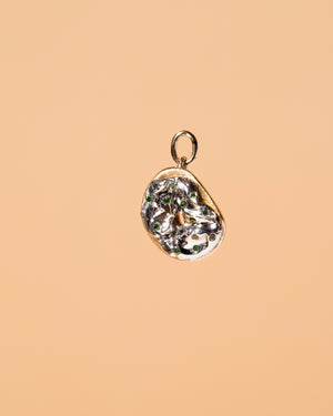 Poppy Seed Bagel Charm with Cream Cheese & Chives on light color background.