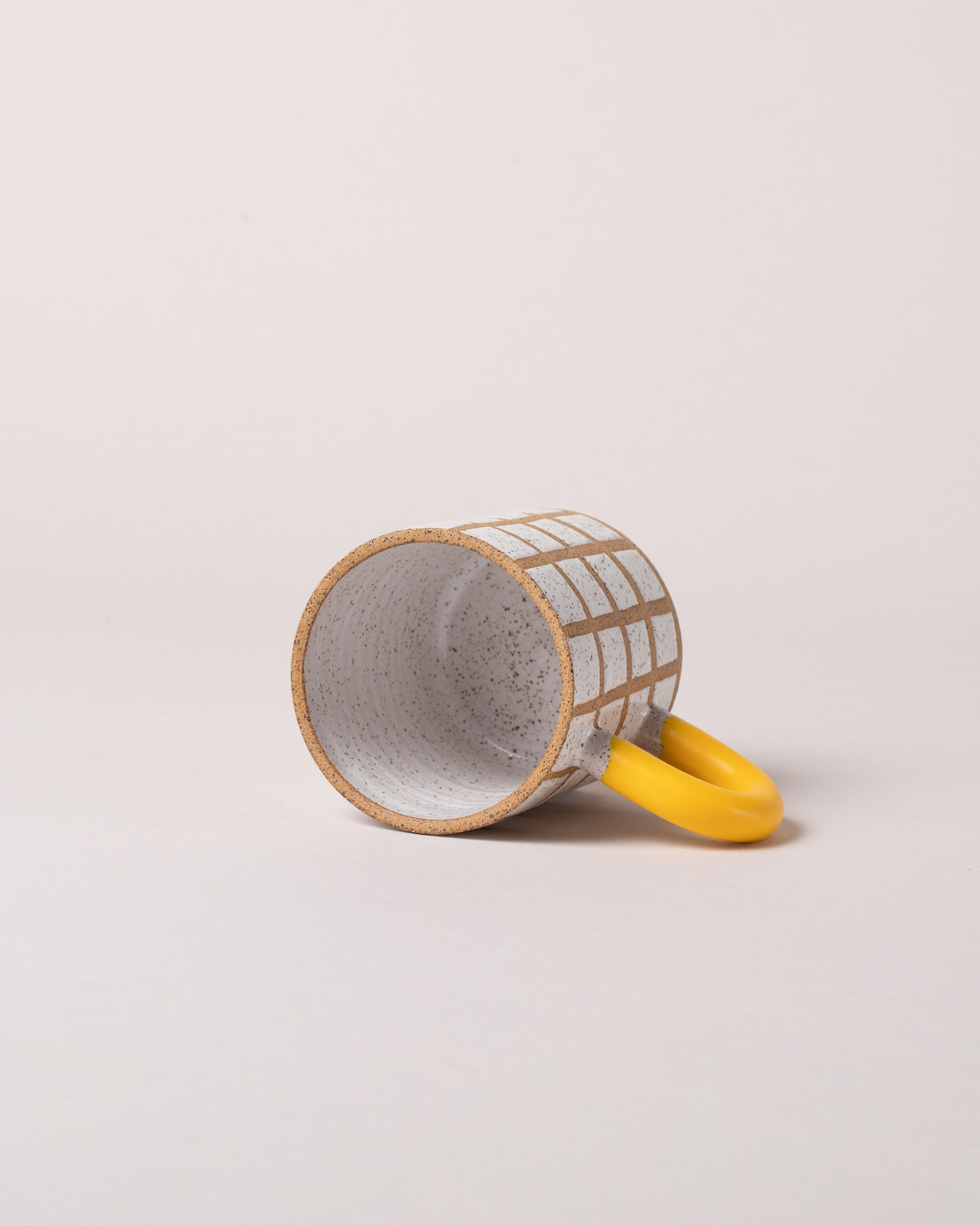 Grid Mug in Yellow Laid Flat