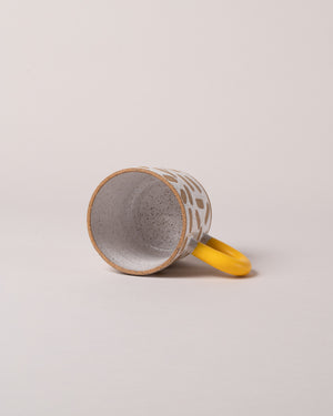 Mark Mug in Yellow Laid Flat