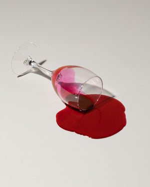 Fake spill of red wine in glass