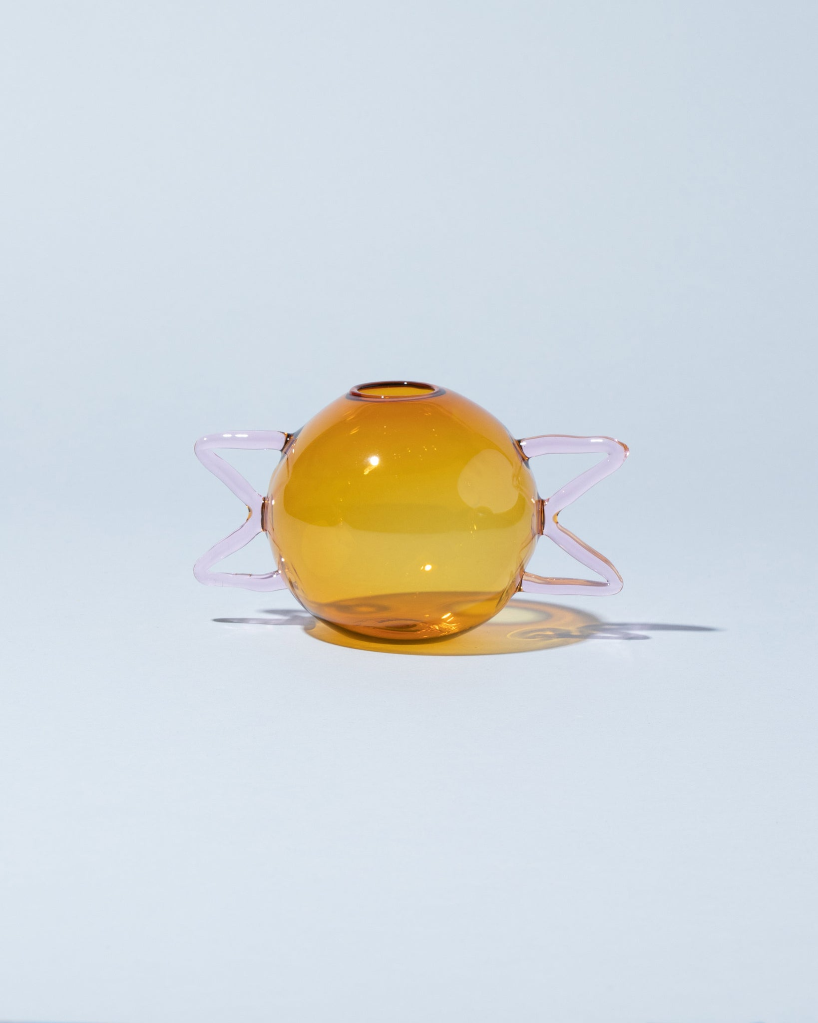 Sophie Lou Jacobsen Squiggle Vase globe in pink and amber front facing