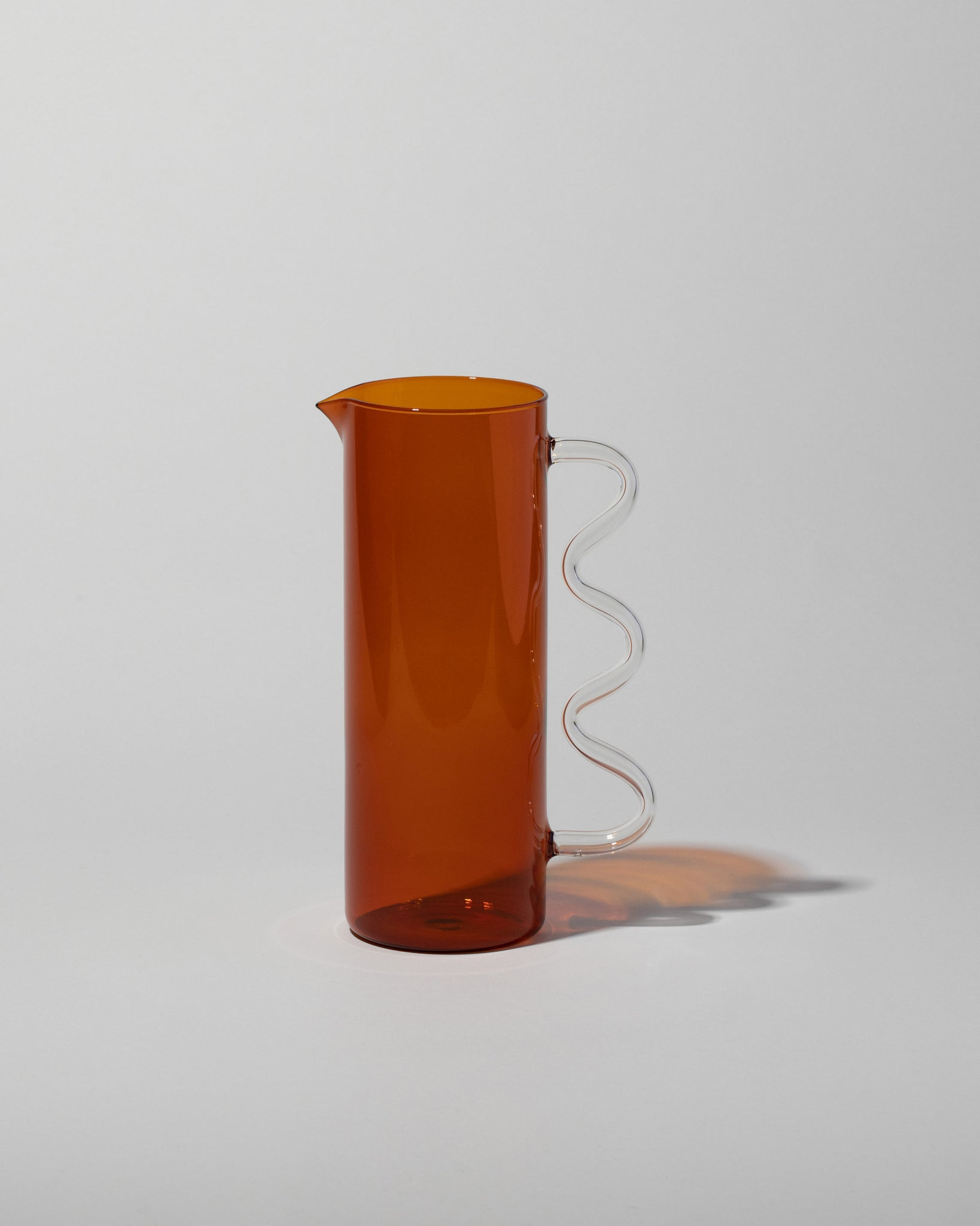 Wave Pitcher Amber with Clear Handle left side view