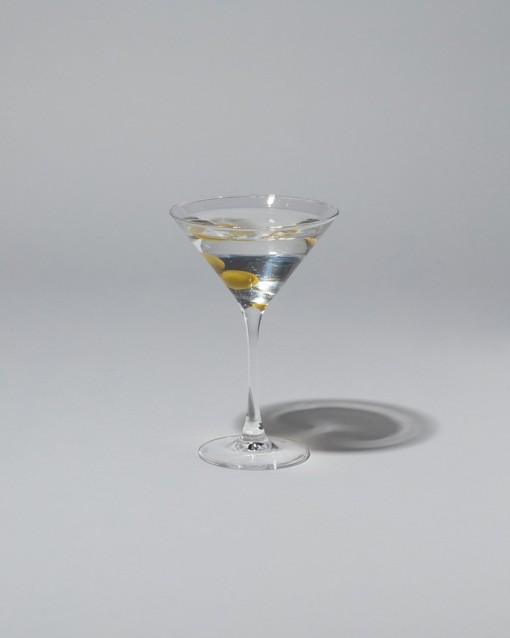 Spills Martini on light color background.
