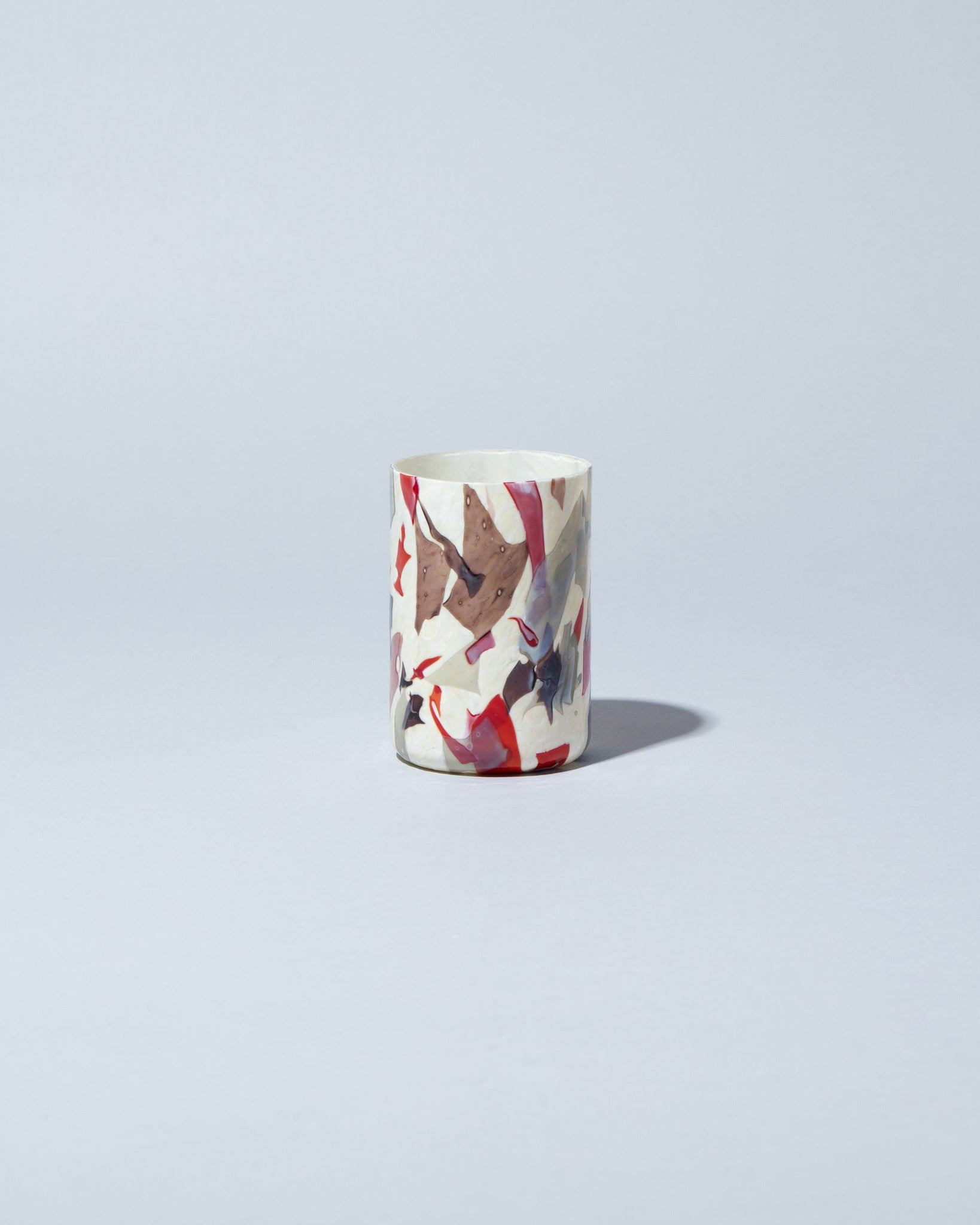 Stories of Italy Nougat Glass Tumbler on light color background.