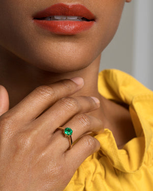 Sun & Moon Emerald Ring on Model Closeup