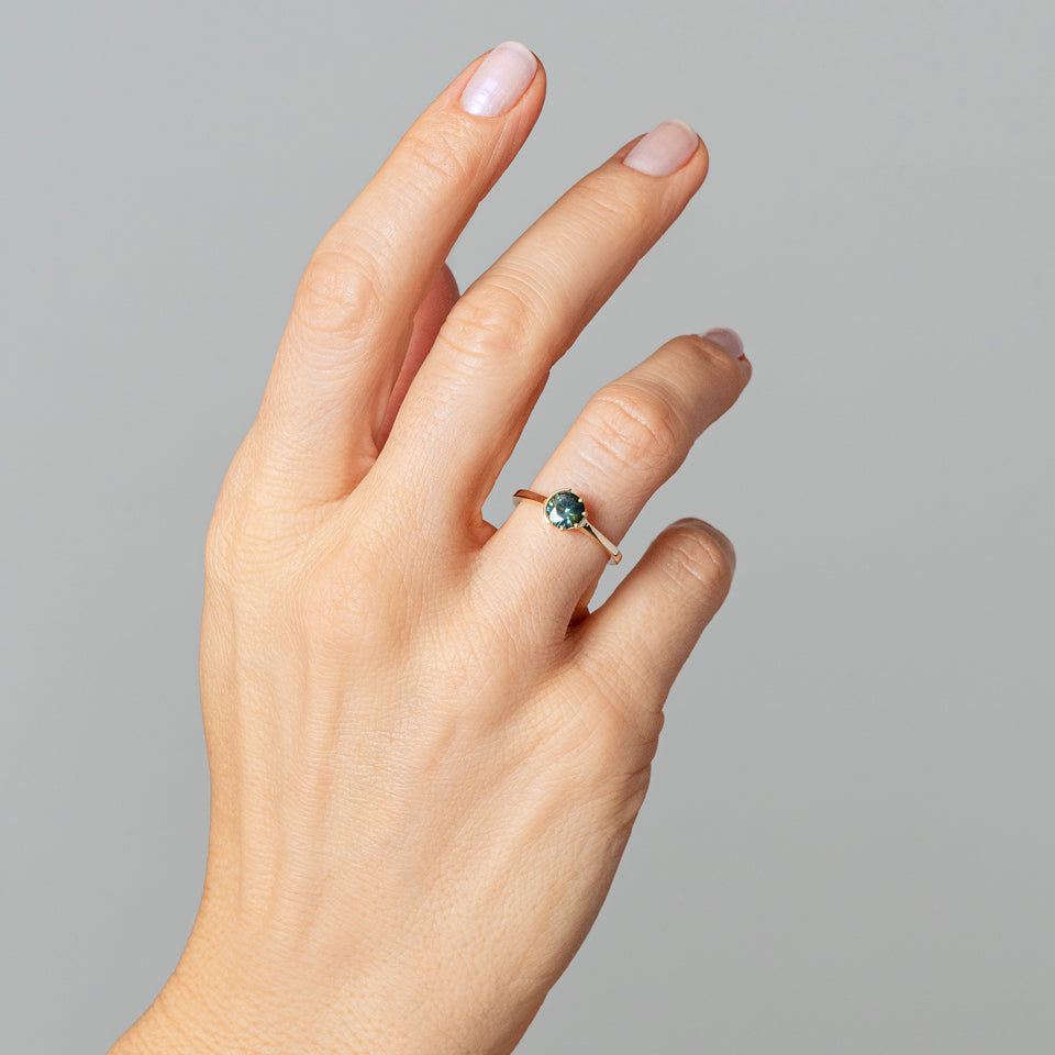 product_details::Bicolor Teal Sapphire Sun & Moon Ring on model