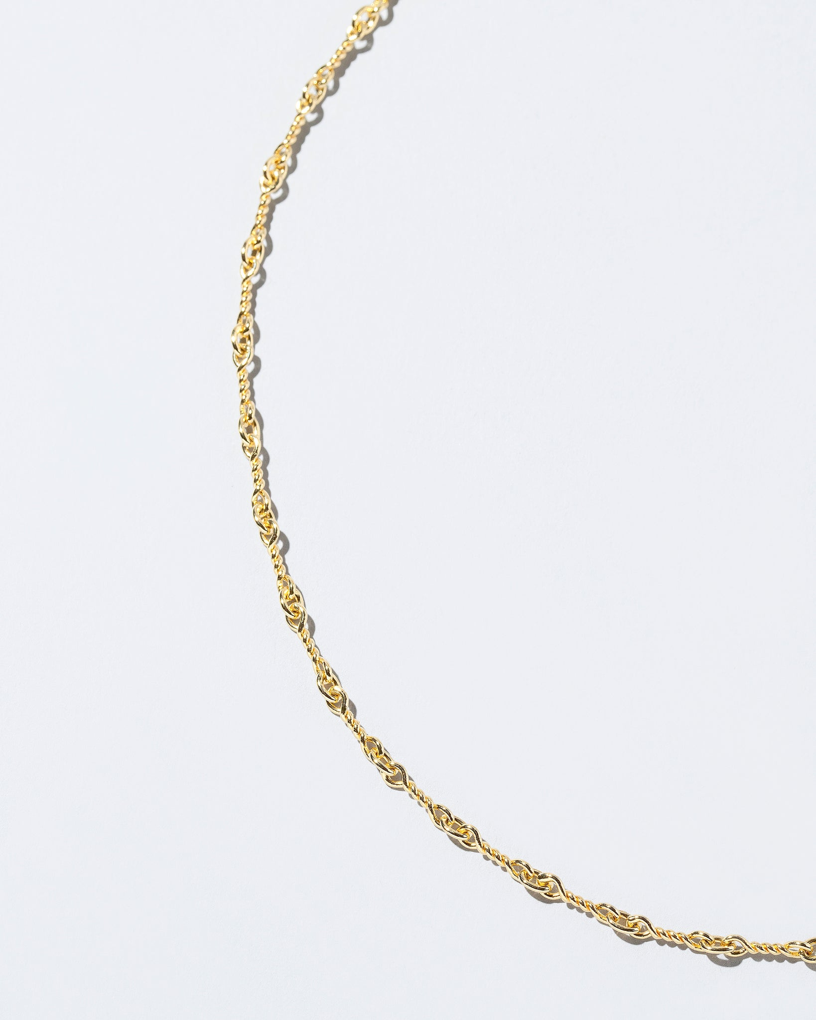 Twisted Chain Necklace on flat surface close up details