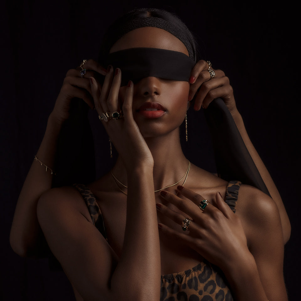 Jewelry from the Talismans collection worn on model