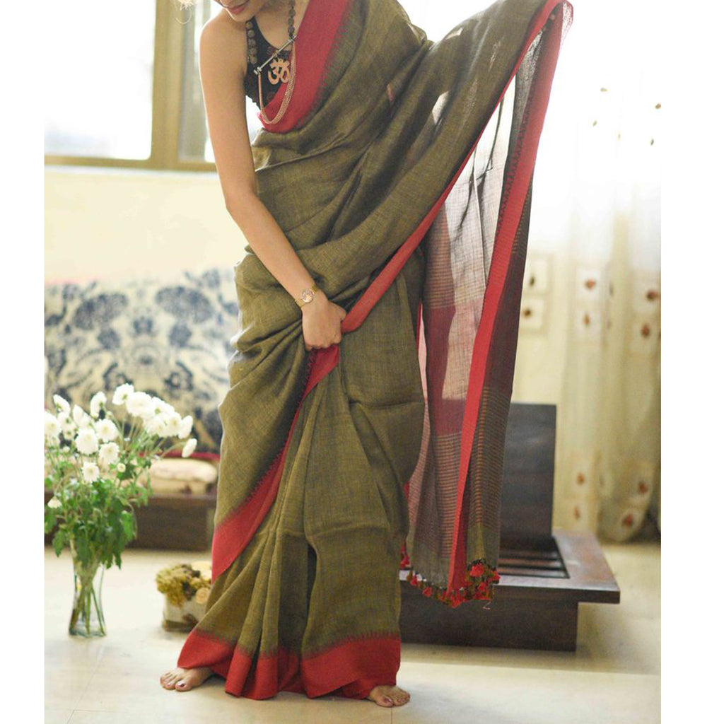 Intricate Green And Red  Colored Festive Wear Pure Linen Designer Saree