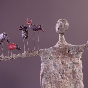 Concrete sculpture man with birds