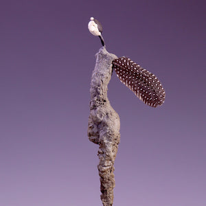 Concrete sculpture female figure with one leg side view