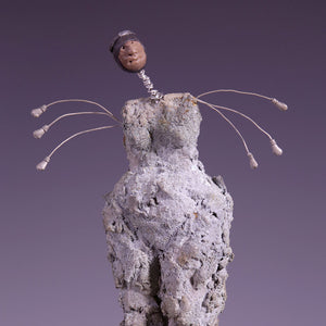 Concrete female figure sculpture