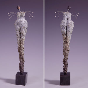 Concrete female figure sculpture with wire arms