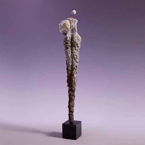 Concrete female figure sculpture no arms back view