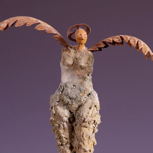 Concrete sculpture female figure with metal wings and crown