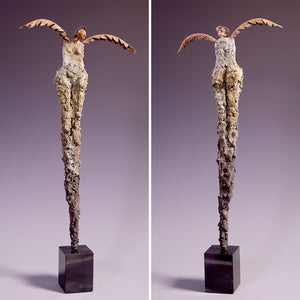 Concrete sculpture female figure with metal wings