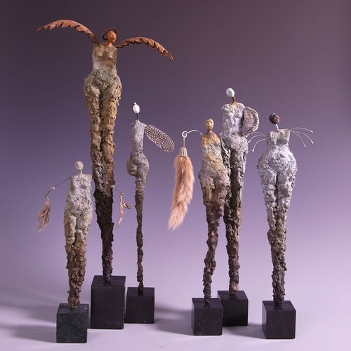 Group of six concrete female figure sculptures