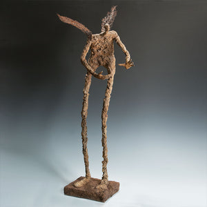 Tall mixed media figure with wings
