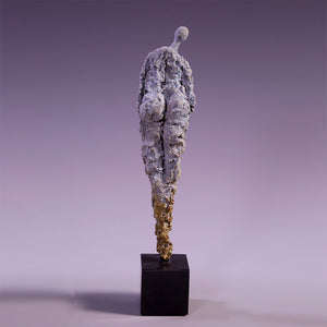 Concrete female figure sculpture back view