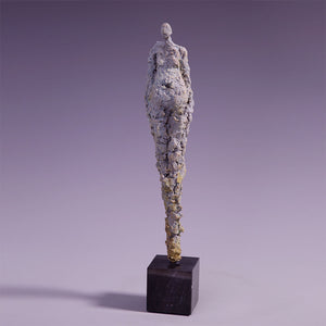 Concrete abstract female figure sculpture front view