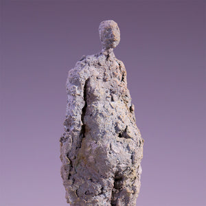 Concrete abstract female figure sculpture
