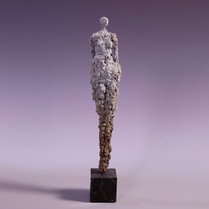 Concrete abstract female figure sculpture on marble base