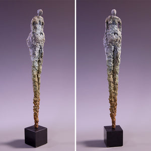 Tall concrete female figure sculpture on marble base