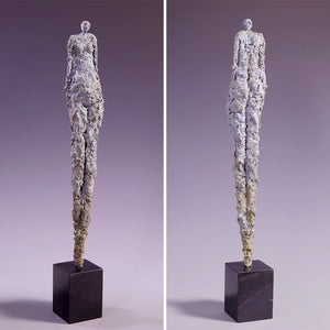 Tall female figure sculpture, concrete on marble base