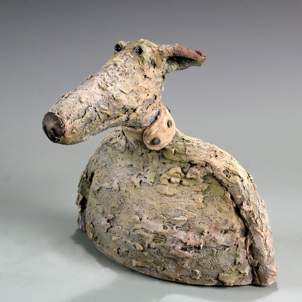 Ceramic dog with long snout